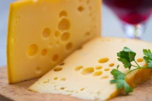 Emental cheese and wine shoot with short DOF